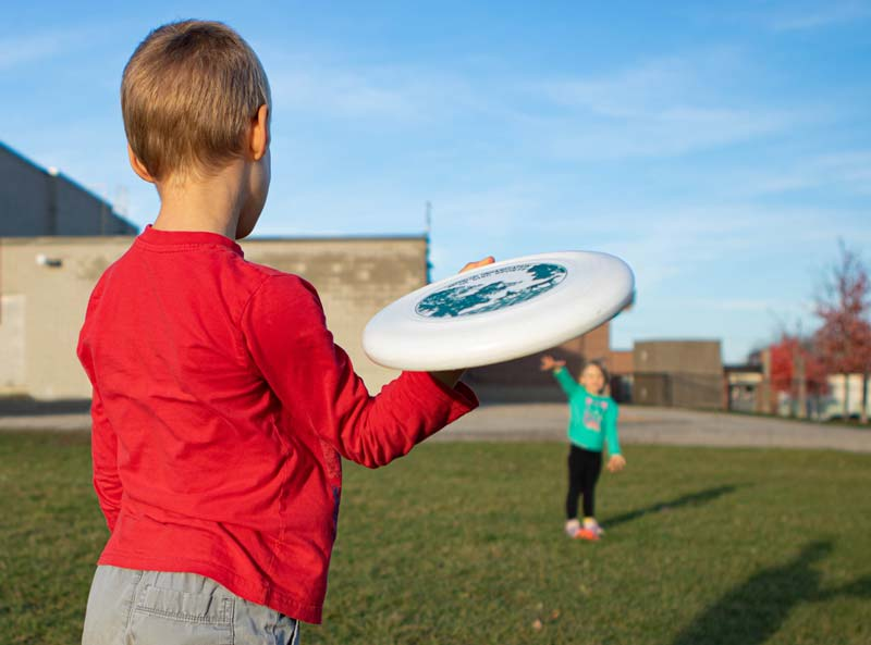 Kids throwing a disc