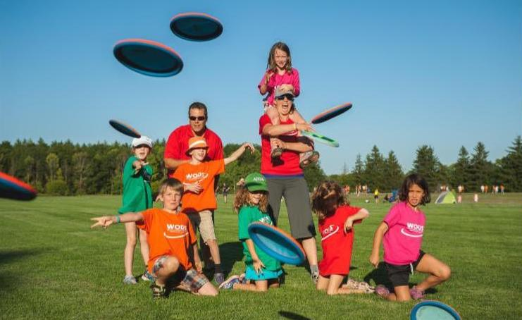 Youth league participants throwing discs